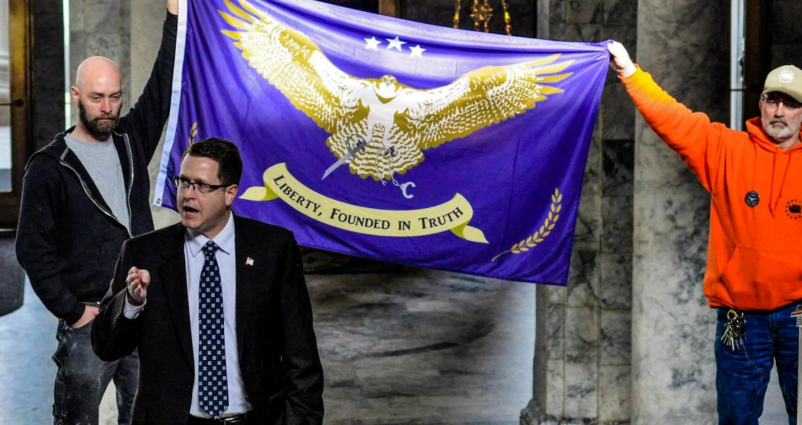 GOP Rep. Matt Shea in front of a Liberty flag